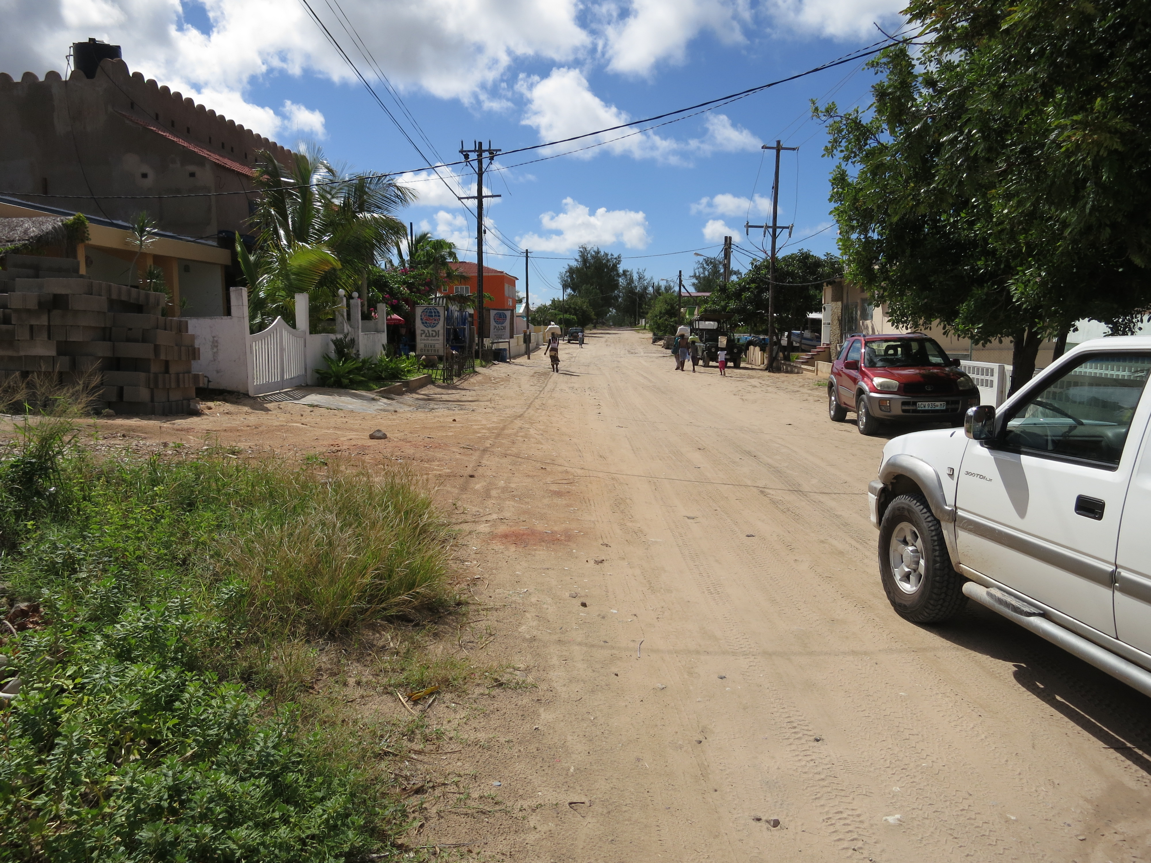 The road into Tofo, and towards the dive centre. See the PADI signs in the distance.